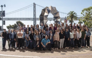 Group photo of the Code for America staff, outside with a bridge in the background
