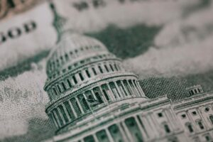 a close up of the U.S. Capitol building on the back of currency